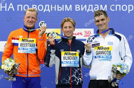 Jordan Wilimovsky (c) of the Usa Poses with His Gold Medal on the Podium After Winning the Men's 10km Open Water Swimming Race at the Fina Swimming World Championships 2015 in Kazan Russia 27 July 2015 Wilimovsky Won Ahead of Second Placed Ferry Weertman (l) of the Netherlands and Third Placed Spyridon Gianniotis (r) of Greece Russian Federation Kazan