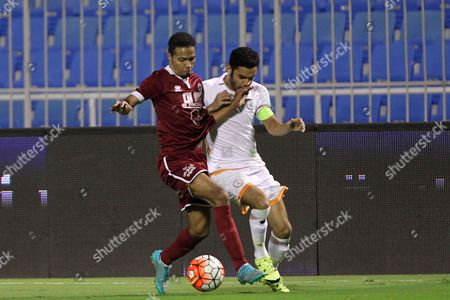 Al-faisaly Player Omar Abdulaziz (l) in Action with Al-shabab Player Abdullah Al-aasta (r) During the Saudi Professional League Soccer Matchábetween Al-sahababáand Al-faisaly at Prince Faisal Bin Fahd Stadium Riyadh Saudi Arabia 14 December 2015 Saudi Arabia Riyadh