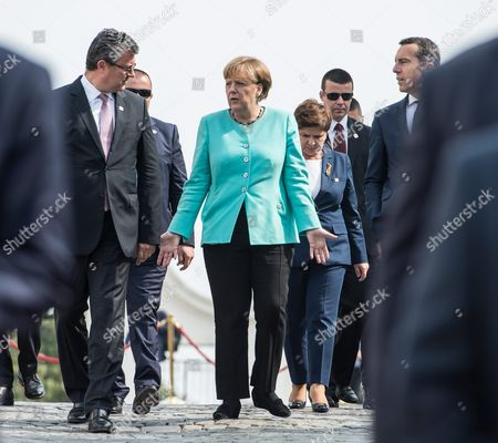 German Chancellor Angela Merkel (c) Croatia's Prime Mnister Tihomir Oreskovic (l) and Austria's Chancellor Christian Kern (r) Chat As They Arrive For a Group Photo Call at the Bratislava Castle During the Bratislava Eu Summit an Informal Meeting of the 27 Heads of State Or Government in Bratislava Slovakia 16 September 2016 European Union Leaders Met to Discuss a New Strategy and Future of the European Union After the Recent Brexit Referendum in Britain Slovakia (slovak Republic) Bratislava