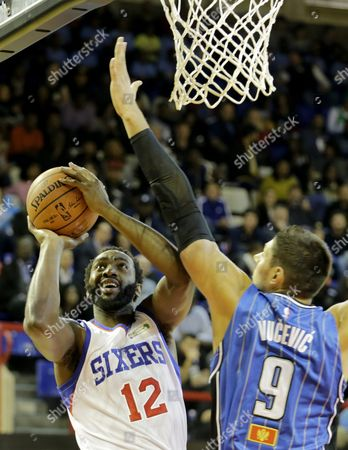 Stock Image of Luc Mbah a Moute From the Africa Team Vies For the Ball with Nikola Vucevic From the World Team During a Basketball Match at the Ellis Park Stadium Johannesburg South Africa 01 August 2015 South Africa Johannesburg