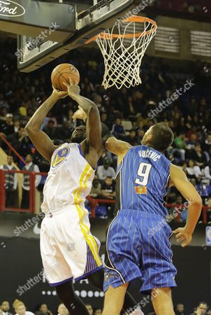 Festus Ezeli From the Africa Team Vies For the Ball with Nikola Vucevic From the World Team During a Basketball Match Played at the Ellis Park Stadium Johannesburg South Africa 01 August 2015 South Africa Johannesburg