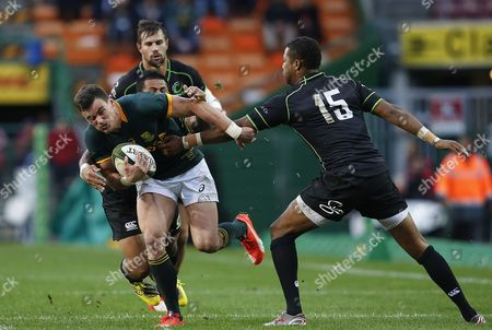 Jesse Kriel of the Springboks (l) is Tackled by David Smith From Samoa Playing For the World Xv (behind) and Delon Armitage From Trinidad and Tobago Playing For the World Xv (r) During the Rugby Match Between South Africa and a World Xv in Cape Town South Africa 11 July 2015 South Africa Cape Town