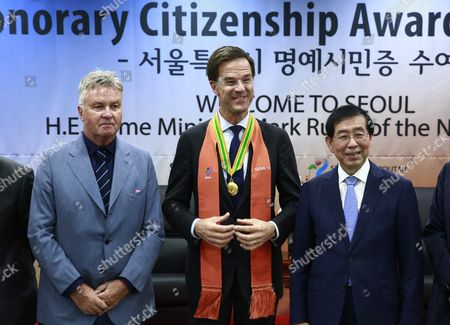 (l-r) Dutch Football Manager Guus Hiddink a Former Head Coach of South Korea's National Football Team; Dutch Prime Minister Mark Rutte and Seoul Mayor Park Won-soon Pose After a Ceremony at the Seoul City Hall in Seoul South Korea 28 September 2016 Rutte is in Seoul on a Three-day Official Visit to Boost Relationships Between the Two Countries Korea, Republic of Seoul