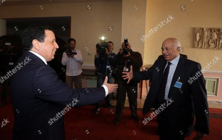 Secretary-general of the Arab League Nabil Elaraby (r) Shakes Hands with Tunisian Foreign Affairs Minister Khemais Jinnaoui (l) As They Arrive For the 8th Ministerial Meeting of Countries Neighboring Libya in Tunis Tunisia 22 March 2016 the Meeting is Devoted to Examining Ways to Support the Political Process in Libya and the Restoration of Peace and Security Tunisia Tunis
