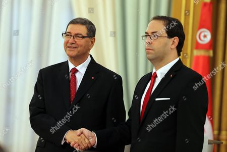 Former Prime Minister Habib Essid (l) Shakes Hands with Tunisia's New Prime Minister Youssef Chahed (r) During a Ceremony Marking the Transfer of Power Between Two Prime Ministers Tunis Tunisia 29 August 2016 the Unity Government Led by Prime Minister-designate Youssef Chahed was Backed by 167 Members of the 217-seat Parliament Tunisia Tunis