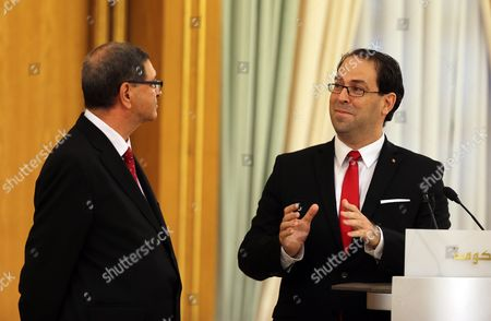 Tunisian New Prime Minister Youssef Chahed (r) Speaks with Outgoing Prime Minister Habib Essid (l) During a Ceremony Marking the Transfer of Power in Tunis Tunisia 29 August 2016 the Unity Government Led by Prime Minister-designate Youssef Chahed was Backed by 167 Members of the 217-seat Parliament Tunisia Tunis