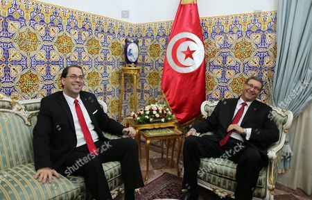 Former Prime Minister Habib Essid (r) Meets with Tunisian New Prime Minister Youssef Chahed (l) During a Ceremony Marking the Transfer of Power Between Two Prime Ministers Tunis Tunisia 29 August 2016 the Unity Government Led by Prime Minister-designate Youssef Chahed was Backed by 167 Members of the 217-seat Parliament Tunisia Tunis