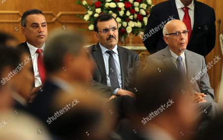 Tunisian Foreign Minister Khemaies Jhinaoui (r) Tunisian Minister of Education Neji Jalloul (c) and Tunisian Interior Minister Hedi Majdoub (l) Attend a Ceremony Marking the Transfer of Power in Tunis Tunisia 29 August 2016 the Unity Government Led by Prime Minister-designate Youssef Chahed was Backed by 167 Members of the 217-seat Parliament Tunisia Tunis