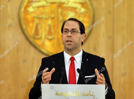 Tunisia's New Prime Minister Youssef Chahed Speaks During a Ceremony Marking the Transfer of Power From Former Prime Minister Habib Essid (not Pictured) Tunis Tunisia 29 August 2016 the Unity Government Led by Prime Minister-designate Youssef Chahed was Backed by 167 Members of the 217-seat Parliament Tunisia Tunis
