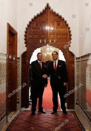 Former Prime Minister Habib Essid (l) Shakes Hands with Tunisian New Prime Minister Youssef Chahed (r ) During a Ceremony Marking the Transfer of Power Between Two Prime Ministers Tunis Tunisia 29 August 2016 the Unity Government Led by Prime Minister-designate Youssef Chahed was Backed by 167 Members of the 217-seat Parliament Tunisia Tunis