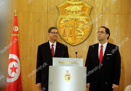 Tunisian New Prime Minister Youssef Chahed (r) During a Ceremony Marking the Transfer of Power From Former Prime Minister Habib Essid (l) Tunis Tunisia 29 August 2016 the Unity Government Led by Prime Minister-designate Youssef Chahed was Backed by 167 Members of the 217-seat Parliament Tunisia Tunis
