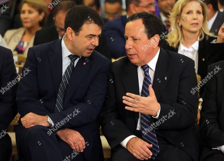 Tunisian Foreign Minister Khemaies Jhinaoui (r) Speaks with Tunisian Interior Minister Hedi Majdoub (l) During a Ceremony Marking the Transfer of Power Between Two Prime Ministers Tunis Tunisia 29 August 2016 the Unity Government Led by Prime Minister-designate Youssef Chahed was Backed by 167 Members of the 217-seat Parliament Tunisia Tunis