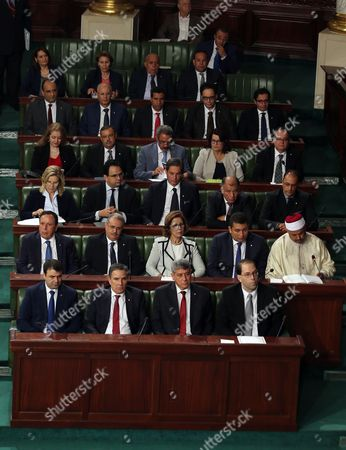 (r-l Bottom) Tunisian Prime Minister Youssef Chahed Along with Justice Minister Ghazi Jeribi Minister of Defense Farhat Horchani and Interior Minister Hedi Majdoub Along with Other Unidentified Members Attend a Plenary Session of the House of People's Representatives (hpr) in Tunis Tunisia 26 August 2016 Tunisia Tunis