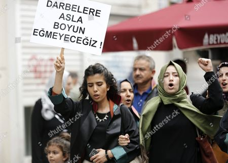 Members of Lawyers Association Hold Placards Reading on 'We Will Never Bow Down Against Coups' As They Shout Slogans Against the 15 July Failed Coup Attempt in Istanbul Turkey 20 July 2016 Turkish Muslim Cleric Fethullah Gulen Living in Self-imposed Exile in the Usa Has Been Accused by Turkish President Recept Tayyip Erdogan of Allegedly Orchestrating the 15 July Failed Coup Attempt at Least 290 People Were Killed and Almost 1 500 Injured Amid Violent Clashes on July 15 As Certain Military Factions Attempted to Stage a Coup D'etat Turkey Istanbul