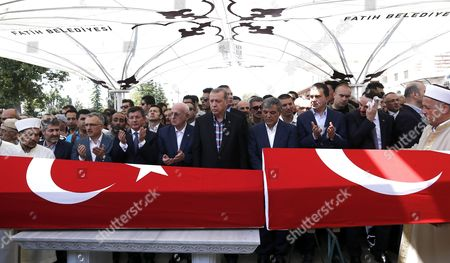 Turkish President Recep Tayyip Erdogan (c) Turkish Parliamentary Speaker Ismail Kahraman (5-l) Former Prime Minister Ahmet Davutoglu (4-l) and Former President Abdullah Gul (4-r) Pray Near by Coffins of Victims who Were Killed in a Coup Attempt on 16 July During the Funeral at Fatih Mosque in Istanbul Turkey 17 July 2016 Turkish Prime Minister Yildirim Reportedly Said That the Turkish Military was Involved in an Attempted Coup D'etat Turkish President Recep Tayyip Erdogan Has Denounced the Coup Attempt As an 'Act of Treason' and Insisted His Government Remains in Charge Some 104 Coup Plotters Were Killed 90 People - 41 of Them Police and 47 Are Civilians - 'Fell Martrys' After an Attempt to Bring Down the Turkish Government the Acting Army Chief General Umit Dundar Said in a Televised Appearance Turkey Istanbul