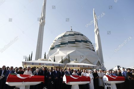 Turkish Parliamentary Speaker Ismail Kahraman Turkish President Recep Tayyip Erdogan and Former President Abdullah Gul Attending Funeral Ceremony of Erol Olcok and His Son Abdullah Tayyip Olcok and Journalist Mustafa Cambaz who Were Killed in a Coup Attempt on 16 July During the Funeral in Istanbul Turkey 17 July 2016 Turkish Prime Minister Yildirim Reportedly Said That the Turkish Military was Involved in an Attempted Coup D'etat Turkish President Recep Tayyip Erdogan Has Denounced the Coup Attempt As an 'Act of Treason' and Insisted His Government Remains in Charge Some 104 Coup Plotters Were Killed 90 People - 41 of Them Police and 47 Are Civilians - 'Fell Martrys' After an Attempt to Bring Down the Turkish Government the Acting Army Chief General Umit Dundar Said in a Televised Appearance Turkey Istanbul