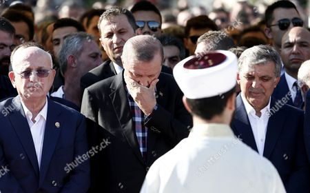 Turkish Parliamentary Speaker Ismail Kahraman Turkish President Recep Tayyip Erdogan and Former President Abdullah Gul Attending Funeral Ceremony of Erol Olcok and His Son Abdullah Tayyip Olcok who Were Killed in a Coup Attempt on 16 July During the Funeral in Istanbul Turkey 17 July 2016 Turkish Prime Minister Yildirim Reportedly Said That the Turkish Military was Involved in an Attempted Coup D'etat Turkish President Recep Tayyip Erdogan Has Denounced the Coup Attempt As an 'Act of Treason' and Insisted His Government Remains in Charge Some 104 Coup Plotters Were Killed 90 People - 41 of Them Police and 47 Are Civilians - 'Fell Martrys' After an Attempt to Bring Down the Turkish Government the Acting Army Chief General Umit Dundar Said in a Televised Appearance Turkey Istanbul