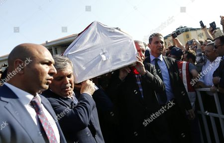 Turkish President Recep Tayyip Erdogan (r) and Former President Abdullah Gul (2-l) Carry Coffins of Erol Olcok and His Son Abdullah Tayyip Olcok who Were Killed in a Coup Attempt on 16 July During the Funeral in Istanbul Turkey 17 July 2016 Turkish Prime Minister Yildirim Reportedly Said That the Turkish Military was Involved in an Attempted Coup D'etat Turkish President Recep Tayyip Erdogan Has Denounced the Coup Attempt As an 'Act of Treason' and Insisted His Government Remains in Charge Some 104 Coup Plotters Were Killed 90 People - 41 of Them Police and 47 Are Civilians - 'Fell Martrys' After an Attempt to Bring Down the Turkish Government the Acting Army Chief General Umit Dundar Said in a Televised Appearance Turkey Istanbul