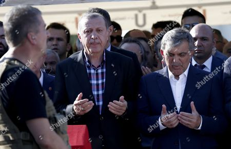 Turkish President Recep Tayyip Erdogan (l) and Former President Abdullah Gul (r) Pray Near by Coffins of Erol Olcok and His Son Abdullah Tayyip Olcok who Were Killed in a Coup Attempt on 16 July During the Funeral in Istanbul Turkey 17 July 2016 Turkish Prime Minister Yildirim Reportedly Said That the Turkish Military was Involved in an Attempted Coup D'etat Turkish President Recep Tayyip Erdogan Has Denounced the Coup Attempt As an 'Act of Treason' and Insisted His Government Remains in Charge Some 104 Coup Plotters Were Killed 90 People - 41 of Them Police and 47 Are Civilians - 'Fell Martrys' After an Attempt to Bring Down the Turkish Government the Acting Army Chief General Umit Dundar Said in a Televised Appearance Turkey Istanbul