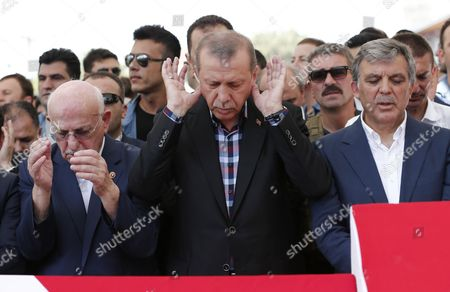 (l-r) Turkish Parliamentary Speaker Ismail Kahraman Turkish President Recep Tayyip Erdogan and Former President Abdullah Gul Pray Near by Coffins of Victims who Were Killed in a Coup Attempt on 16 July During the Funeral at Fatih Mosque in Istanbul Turkey 17 July 2016 Turkish Prime Minister Yildirim Reportedly Said That the Turkish Military was Involved in an Attempted Coup D'etat Turkish President Recep Tayyip Erdogan Has Denounced the Coup Attempt As an 'Act of Treason' and Insisted His Government Remains in Charge Some 104 Coup Plotters Were Killed 90 People - 41 of Them Police and 47 Are Civilians - 'Fell Martrys' After an Attempt to Bring Down the Turkish Government the Acting Army Chief General Umit Dundar Said in a Televised Appearance Turkey Istanbul