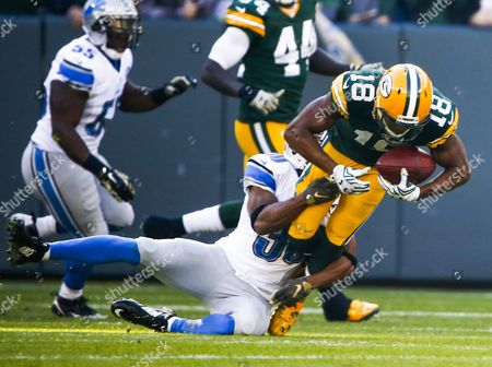 Green Bay Packers Wide Receiver Randall Cobb (r) is Tackled by Detroit Lions Defensive Back Josh Wilson (l) During the Nfl American Football Game Between the Detroit Lions and the Green Bay Packers at Lambeau Field in Green Bay Wisconsin Usa 15 November 2015 United States Green Bay