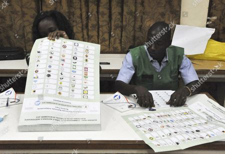 Stock Photo of Electoral Officals Ready Themselves with Ballot Papers For the General Elections in Ouagadougou Burkina Faso 29 November 2015 Polls Opened in Burkina Faso's Presidential and Parliamentary Election on 29 November with Expectations High One Year After a Violent Public Uprising Forced the Long-time President out of Office It is the First Election in the Country After President Blaise Compaore was Forced From Office Last Year Which Sparked a Year of Political Uncertainty Thousands Are Expected to Vote to Elect a New President and Parliament with Roch Marc Christian Kabore and Zephirin Diabre Seen As Strongest Contenders For President Burkina Faso Ouagadougou