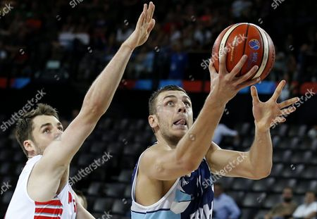 Stock Photo of Poland's Aleksander Czyz (l) in Action Against Bosnia's Elmedin Kikanovic (r) During the Eurobasket 2015 Group a Match Between Poland and Bosnia and Herzegovina at the Park and Suites Arena in Montpellier France 05 September 2015 France Montpellier