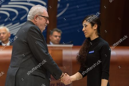 President of the Council of Europe (pace) Pedro Agramunt (l) Congratulates Former is Prisoner Nadia Murad (r) For Winning the Vaclav Havel Human Rights Prize in the Council of Europe in Strasbourg France 10 October 2016 the 23-year-old Jesidis Fights Against the Enslavement of Her Faithmakers in the Northern Iraq by Islamic State (is) Militants the Young Woman Had Found Refuge in Baden-wuerttemberg Through a Special Program France Strasbourg