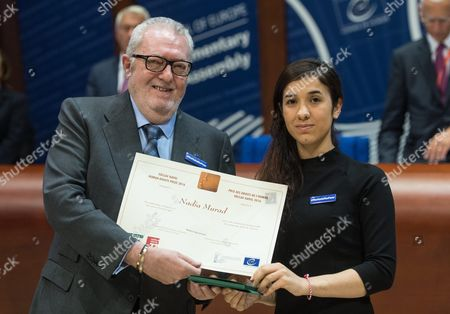 President of the Council of Europe (pace) Pedro Agramunt (l) Presents the Vaclav Havel Human Rights Prize to the Former is Prisoner Nadia Murad (r) at the Council of Europe in Strasbourg France 10 October 2016 the 23-year-old Jesidis Fights Against the Enslavement of Her Faithmakers in the Northern Iraq by Islamic State (is) Militants the Young Woman Had Found Refuge in Baden-wuerttemberg Through a Special Program France Strasbourg