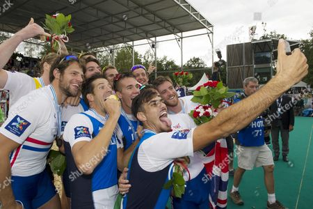Italy's (foreground From Left Blue Shirts) Gold Medalists Matteo Castaldo Matteo Lodo and Giuseppe Vicino Take a Picture with Silver Medalists Australia and Bronze Winners Great Britain (left is Tom Ransley) After the Medal Ceremony For the Men's Four Final at the 2015 Rowing World Championships on Lake Aiguebelette Near Chambery France 05 September 2015 France Chambery