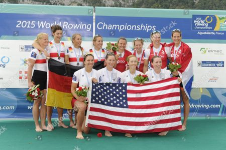 Silver Medal Winners Germany's (back Left From Left) Annekatrin Thiele Carina Baer Marie-catherine Arnold and Lisa Schmidla Gold Medal Winners Usa (foreground From Left) Amanda Elmore Tracy Eisser Megan Kalmoe and Olivia Coffey Bronze Medal Winners the Netherlands (from Left) Nicole Beukers Chantal Achterberg Inge Janssen and Carline Bouw During the Medal Ceremony For the Women's Quadruple Sculls Final Aty the 2015 Rowing World Championships on Lake Aiguebelette Near Chambery France 05 September 2015 France Chambery