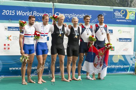 (from Left) Second Placed James Foad and Matt Langridge of Great Britain Winners New Zealand's Eric Murray and Hamish Bond and Third Placed Milos Vasic and Nenad Bedik of Serbia During the Medal Ceremony For the Men's Pair Final of the 2015 Rowing World Championships on Lake Aiguebelette Near Chambery France 05 September 2015 France Chambery