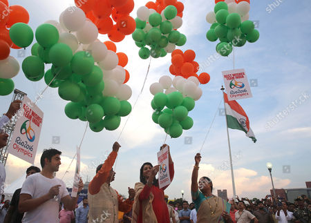(l-r) Indian Cricketer Gautam Gambhir Indian Sports Minister Vijay Goyal Indian Athlete Anju Bobby George and Indian Weight Lifter and First Indian Woman Olympics Medal Winner Karnam Malleswari Release the Indian Tri Colour Balloons to Support the Indian Olympic Contingent in New Delhi India 05 August 2016 the Rio 2016 Olympics Will Take Place From 05 August Until 21 August 2016 in Rio De Janeiro Brazil India New Delhi