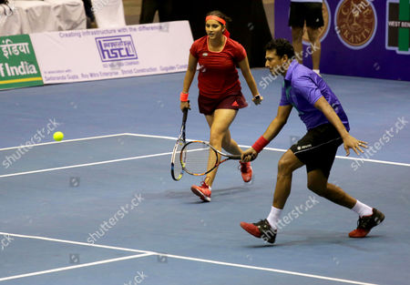 Indian Tennis Players Sania Mirza (l) and Mahesh Bhupathi (r) in Action During an Exhibition Match of the Tennis Masters in Calcutta Eastern India 25 November 2015 India Calcutta