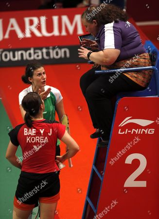 Linda Zetchiri (2-l) of Bulgaria Protests to the Referee During Her Women's Singles Qualification Match Against Bae Yeon Ju (l) of South Korea at the Badminton 2015 Total Bwf World Championships in Jakarta Indonesia 12 August 2015 Indonesia Jakarta