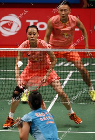 Stock Picture of Zhang Nan (top R) and Zhao Yunlei (top L) of China in Action Against Lie Chen and Bao Yixing of China During Their Mixed Doubles Final Match at the Total Bwf Badminton World Championships in Jakarta Indonesia 16 August 2015 Indonesia Jakarta