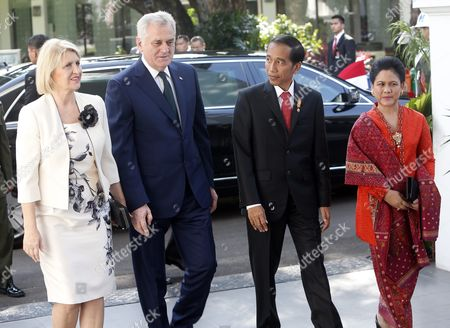 Indonesian President Joko Widodo (2-r) and Wife Iriana Joko Widodo (r) Welcome President of Serbia Tomislav Nikolic (2-l) and Wife Dragica Nikolic (l) During Arrival at Merdeka Palace in Jakarta Indonesia 27 April 2016 Nikolic Accompanied by Several Leading Businessmen of the Country is Visiting Indonesia to Discuss Bilateral Ties Indonesia Jakarta