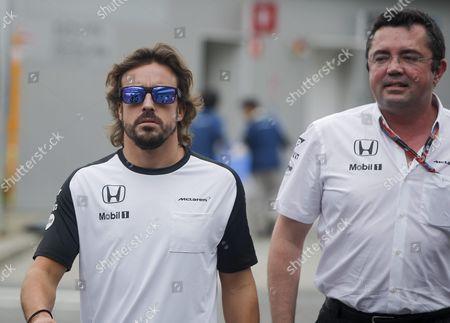 Spanish Formula One Driver Fernando Alonso (l) of Mclaren-honda Walks Through the Paddock with Mclaren-honda Team Chief Eric Boullier Ahead of the Japanese Formula One Grand Prix at the Suzuka Circuit in Suzuka Central Japan 27 September 2015 Japan Japan