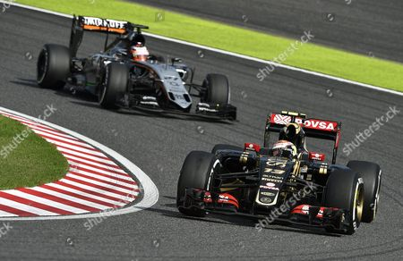 Venezuelan Formula One Driver Pastor Maldonado (front) of the Lotus F1 Team Steers His Car Ahead of German Driver Nico Huelkenberg (l) of the Sahara Force India F1 Team During the Japanese Formula One Grand Prix at the Suzuka Circuit in Suzuka Central Japan 27 September 2015 Japan Suzuka