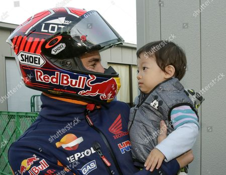 Stock Picture of Spanish Motogp Rider Marc Marquez of Repsol Honda Team Holds 22-month Old Japanese Boy Fan Ryoya (r) After a Course Inspection at Twin Ring Motegi Circuit Prior to the Motogp Motorcycling Grand Prix of Japan in Motegi North of Tokyo Japan 08 October 2015 the Final Race Will Be Held on 11 October 2015 Japan Tokyo