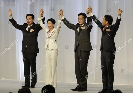 Renho Murata (c) Raises Her Arms with Her Contenders Seiji Maehara (l) Yoichiro Tamaki (r) and Present Party Chief Katsuya Okada During a Convention Selecting Japan's Main Opposition Democratic Party's New Chief in Tokyo Japan 15 September 2016 Renho Murata Has Been Appointed As First Female Leader of the Party She Succeeds Katsuya Okada Japan Tokyo