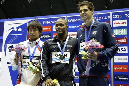 Gold Medalist Giles Smith (c) of the Usa is Flanked by Silver Medalist Takeshi Kawamoto (l) of Japan and Bronze Medalist Michael Andrew (r) of the Usa During the Medal Ceremony For the Men's 50m Butterfly Competition of the Fina Swimming World Cup 2015 at Tokyo Tatsumi International Swimming Center in Tokyo Japan 28 October 2015 Japan Tokyo