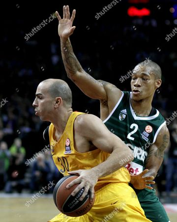 Jerome Randle (r) of Zalgiris Kaunas and Carlos Arroyo of Barcelona Lassa During Euroleague Top 16 Game Between Zalgiris Kaunas and Barcelona Lassa in Kaunas Lithuania 7 April 2016 Lithuania Kaunas