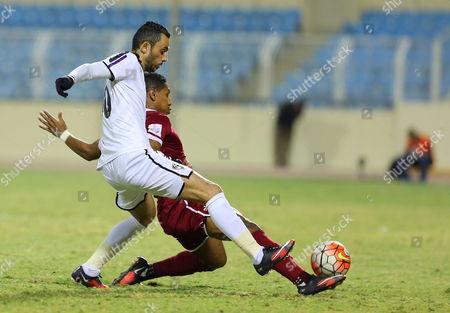 Hajer Player Ashraf Noaman (l) in Action For the Ball with Al-faisaly Player Omar Abdulaziz (r) During the Saudi Arabia Professional League Soccer Match Between Hajer and Al-faisaly at Prince Abdullah Bin Jalawi Stadium Al-hasa Saudi Arabia 26 February 2016 Saudi Arabia Al-hasa