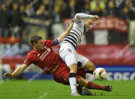 Liverpool's James Milner (l) in Action with Bordeaux's Diego Contento (r) During the Uefa Europa League Group B Soccer Match Between Liverpool Fc and Fc Girondins De Bordeaux Held at Anfield in Liverpool Britain 26 November 2015 United Kingdom Liverpool