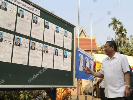 Stock Image of Laos President Choummaly Sayasone Checks Candidates Lists During the Elections For the National Assembly at a Polling Station in Vientiane Laos 20 March 2016 Laos is a One-party Socialist State Rulied by Lao People's Revolutionary Party Lao People's Democratic Republic Vientiane