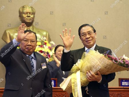 A Photo Made Available on 21 April 2016 Shows Outgoing Laos President Choummaly Sayasone (r) and Newly Elected Head of State Bounnhang Vorachit (l) Wave to Delegates and Officials During the National Assembly in Vientiane Laos 20 April 2016 Laos National Assembly Elected Thongloun As a New Prime Minister and Bounnhang Vorachit As the Head of State Laos is a One-party Socialist State Ruled by Lao People's Revolutionary Party Lao People's Democratic Republic Vientiane