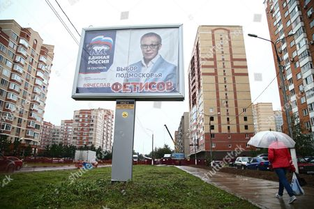 Stock Picture of A Woman Walks by the Elections Poster of Former Ice Hockey Player Viacheslav Fetisov From the United Russia Party in Moscow Russia 16 September 2016 Parliamentary Elections in Russia Are Scheduled to Be Held on 18 September 2016 Russian Federation Moscow