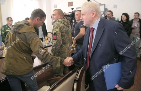 Sergei Mironov (r) Leader of Just Russia Party Meets with Participants of Combat Actions in Eastern Ukraine During His Parliament Elections Campaign in Moscow Russia 13 September 2016 Parliamentary Elections in Russia Are Scheduled to Be Held on 18 September 2016 Russian Federation Moscow