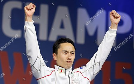 Yuki Ota of Japan Celebrates on the Podium After Beating Alexander Massialas of the Usa in Their Men's Foil Individual Final of the World Fencing Championships in Moscow Russia 16 July 2015 Ota Won the Gold Medal Russian Federation Moscow